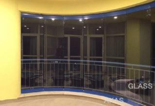 Безрамное остекление балкона системой «Книжка» в Москве