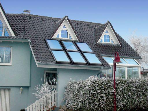 Частный дом с мансардными окнами и стеклянной верандой